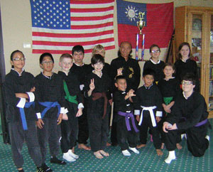 Eric Lee picture with Wang's Martial Arts students.